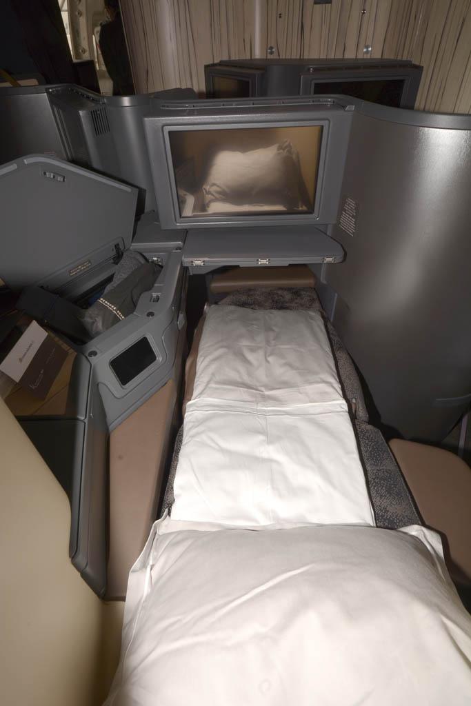 El asiento de business en posición cama.