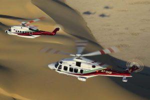 Un S-92 (arriba) y un AW189 de Gulf Helicopters en vuelo.