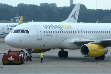 "Airbus A320 EC-MFN de Vueling, bautizado ""In Vueling we trust""."