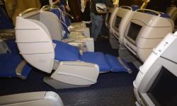 Los asientos de business  del Boeing 777 de Privilege se convierten en camas planas.
