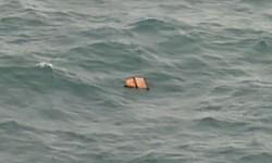 Imagen de la televisión indonesia de los restos del vuelo QA8501