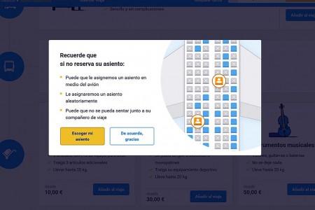 Aviso en la web de Ryanair al comprar un vuelo para más de un pasajero y no pagar para elegir los asientos asignados.